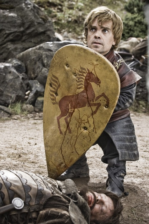 Tyrion Lannister with a shield from HBO's GAME OF THRONES